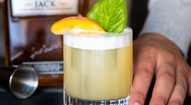 The Peach Basil Whiskey Sour