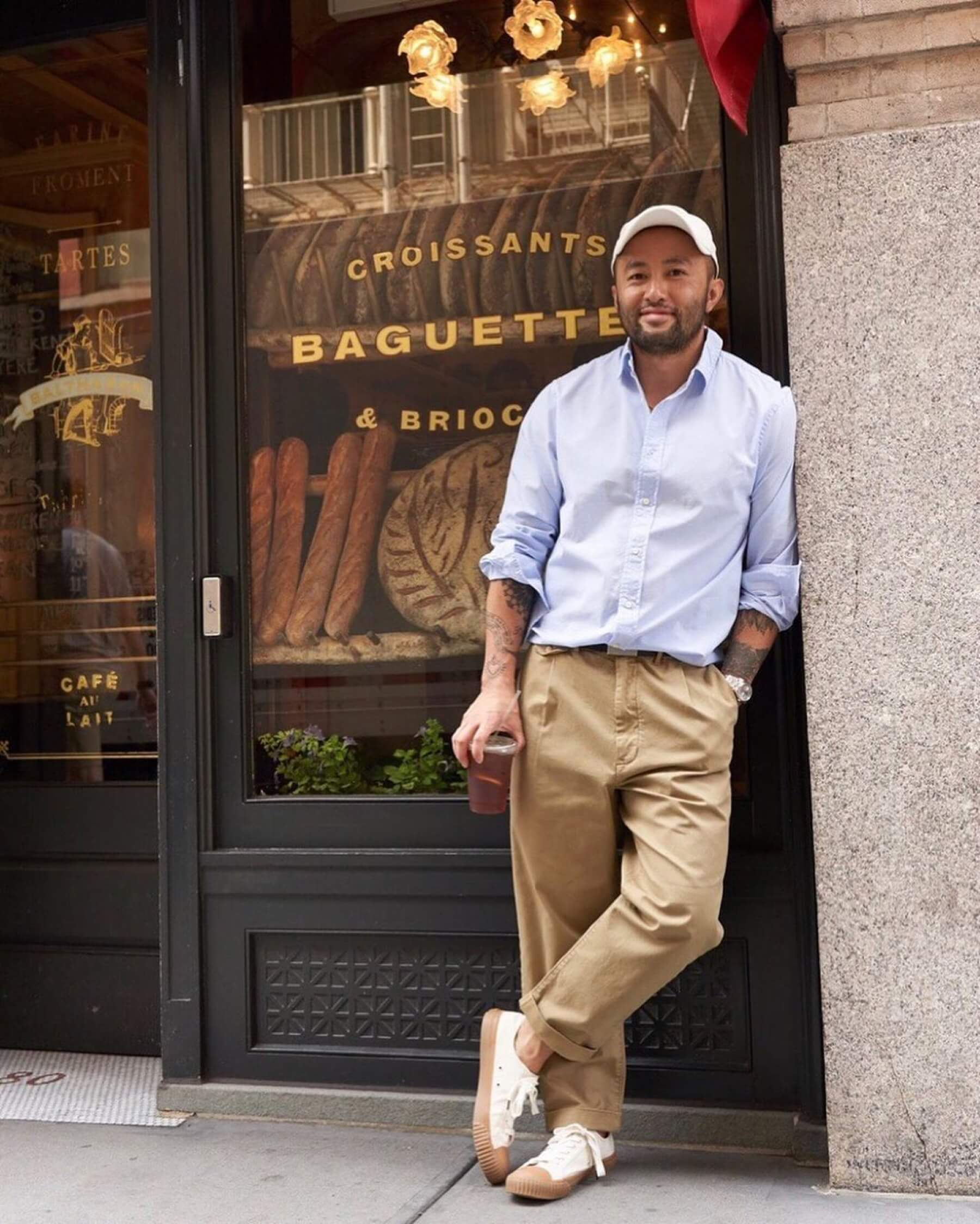 Somsack Sikhounmuong of Alex Mill wearing pleated chinos