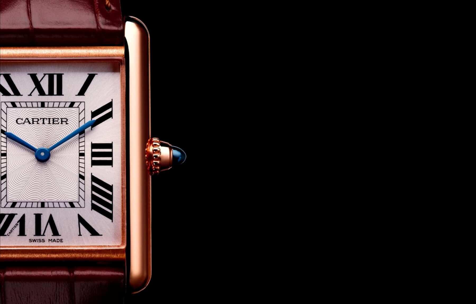 18k Gold Cartier Tank watch close-up